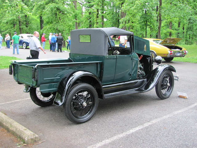 The owner is pictured here with his truck in French Lick, Indiana at the Model A Restorers Club's National Meet where the truck scored 454 points out of 500, and was awarded the Ray Matthews Award for the highest scoring commercial vehicle and it received the MARC of Excellence award.